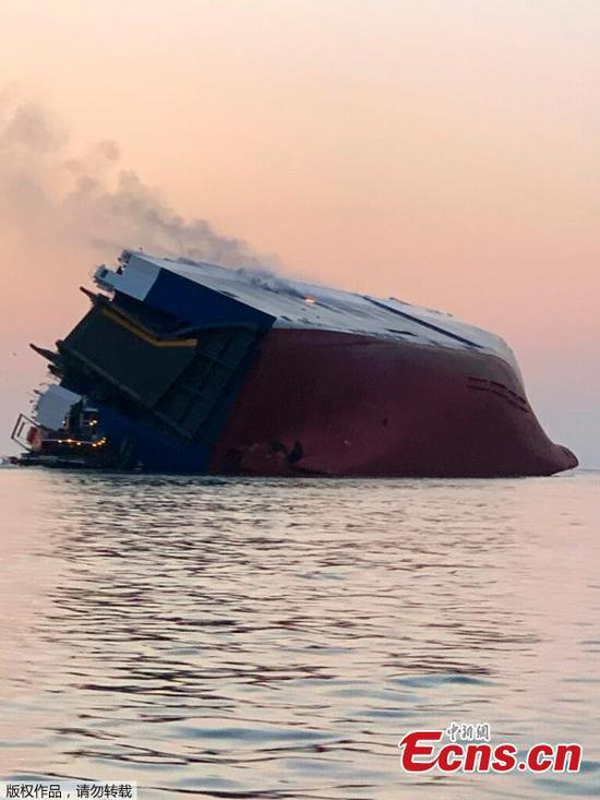 4 missing from overturned cargo ship near Georgia