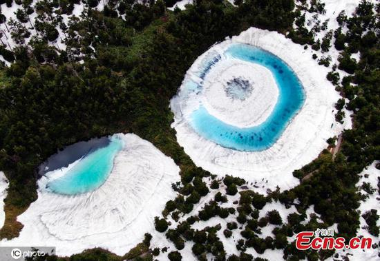 'Dragon Eye' pond in Japan 'wakes up' as snow and ice melts