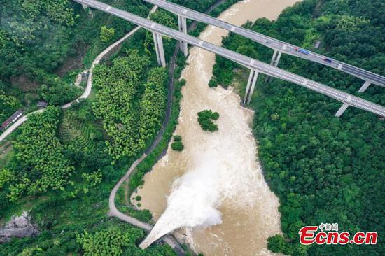 Dam discharges flood as result of heavy rainfalls in Anhui