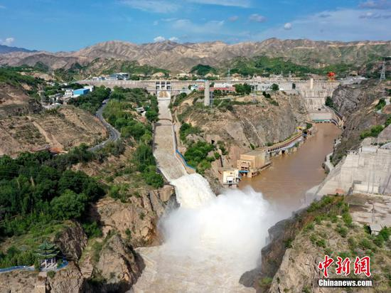 Water gushes out from sluiceway of Liujiaxia Reservoir on Yellow River