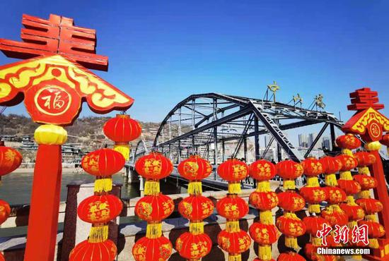 The first bridge of the Yellow River decorated with red lanterns for Spring Festival