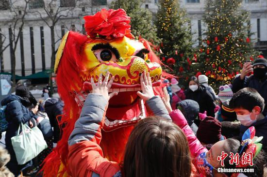 People watch lion dance performance in New York