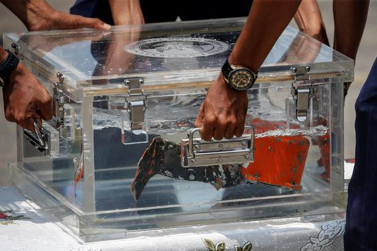 Voice recorder recovered from crashed Indonesia plane